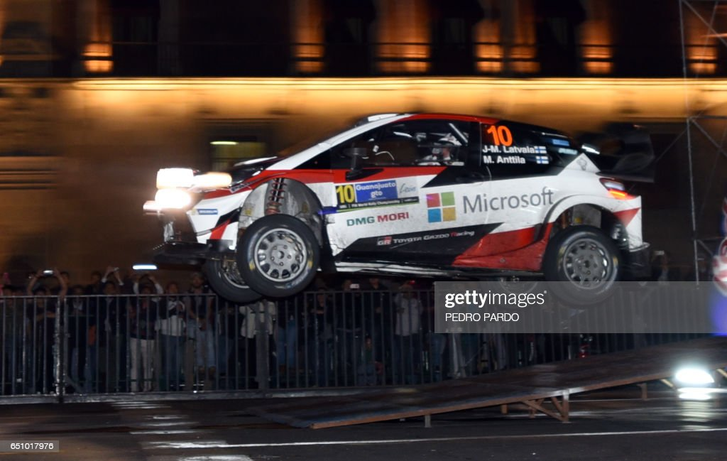 Finnish Jari-Matti Latvala and his co-driver Mikka Anttila of Toyota Gazoo Racing WRT gets air during the street stage on the first day of the FIA World Rally Championship's in Mexico City, on Marc...