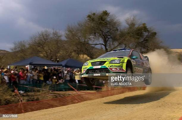 Finnish Jari-matti Latvala jumps with his Ford Focus during the second day of the FIA World Rally Championship's in Leon, Mexico, on March 1, 2008....