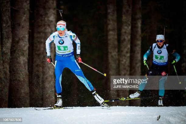 Finnish Kaisa Makarainen and French Justine Braisaz compete during the Mixed Relay competition of the IBU Biathlon World Cup in Pokljuka on December...
