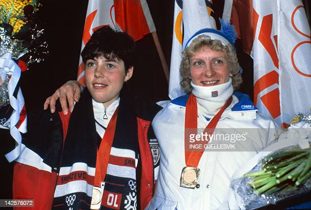 Finnish MarjaLiisa Hämäläinen smiles next to Norwegian Brit Pettersen after the medals' ceremony of the women's 10km cross country classical race 09...