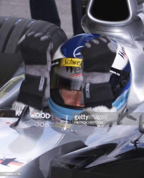 Finnish McLarenMercedes driver Mika Hakkinen clenches his fists after winning the poleposition at the end of the qualifying session in Spielberg 24...