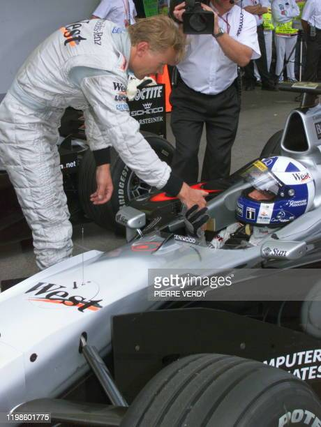 Finnish McLarenMercedes driver Mika Hakkinen congratulates his teammate David Coulthard after winning the poleposition at the end of the qualifying...