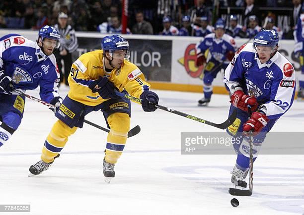 Finnish Mika Py?r?l? and Swedish Per Ledin play in the icehockey Euro Hockey Tour match Finland vs Sweden in Helsinki 11 November, 2007. Rear is...