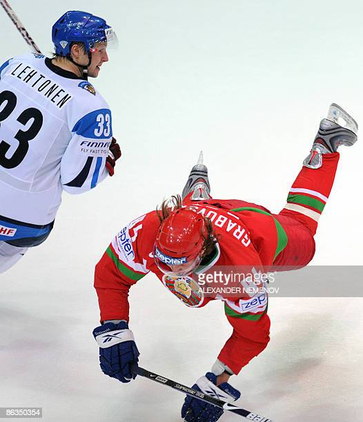 Finnish Mikko Lehtonen sends Belerusian Mikhail Grabovski of Toronto Maple Leafs down during their qualifying round group F game of the IIHF...