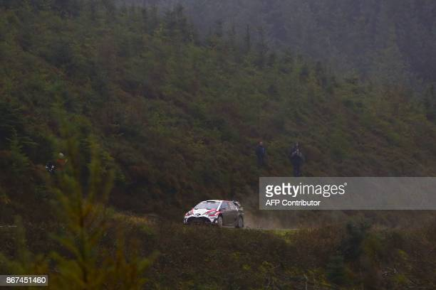 Finnish pilot Esapekka Lappi and co pilot Janne Ferm of Toyota Gazoo Racing WRT drive their Toyota Yaris WRC during special stage 11 of the Wales...