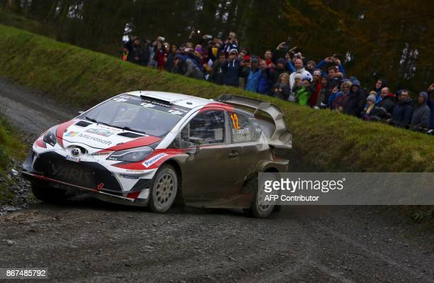 Finnish pilot Esapekka Lappi and co pilot Janne Ferm of Toyota Gazoo Racing WRT drive their Toyota Yaris WRC during special stage 13 of the Wales...