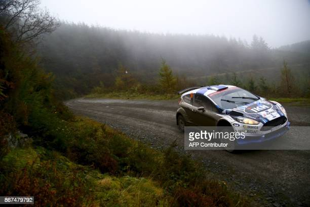 Finnish pilot Kalle Rovanpera and co pilot Jonne Halttunen compete in their Ford Fiesta R5 during special stage 11 of the Wales Rally GB the...