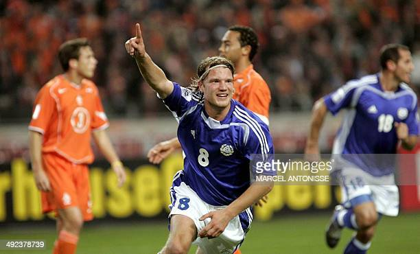 Finnish player Teemu Tainio cheers after scoring the first goal 13 October 2004 during World Cup 2006 qualifier in the Amsterdam Arena stadium AFP...