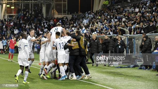 Finnish players celebrate a goal during the UEFA Euro 2020 Group J qualification football match between Finland and Liechtenstein in Helsinki,...