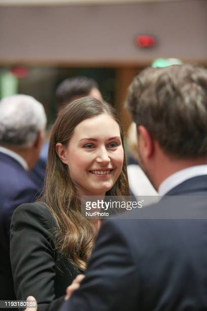 Finnish PM talks to PM of Luxembourg Xavier Bettel. Prime Minister of Finland Sanna Mirella Marin on the round table room during the second of the...