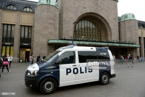 Finnish police patrols in front of the Cenral Railway Station in Helsinki on August 18 2017 Finnish Police announced they will rise the readiness...
