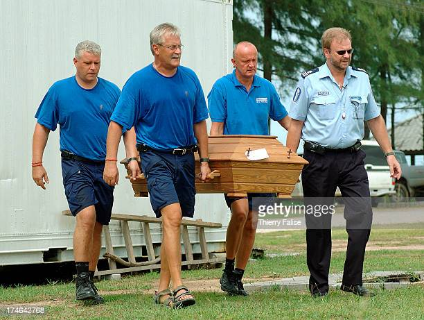Finnish policeman Ismo Kopra head of the Disaster Victim Identification team from Finland in Phuket He is helping colleagues to carry the coffin of a...