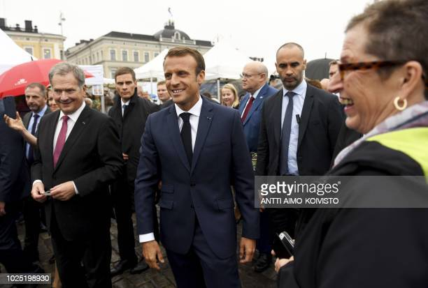Finnish President Sauli Niinistö and French President Emmanuel Macron walk outside of the Presidential Palace after their joint press conference in...