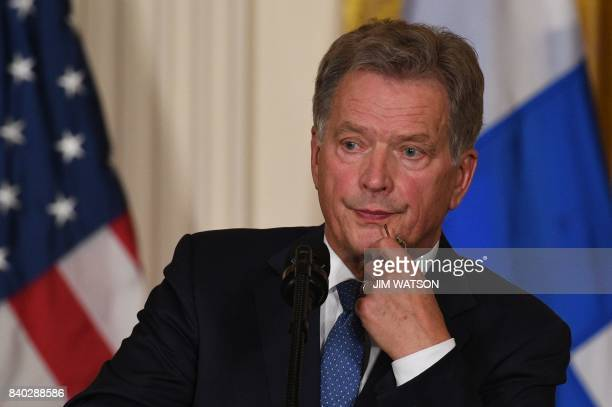 Finnish President Sauli Niinistö holds a joint press conference with US President Donald Trump on August 28 at the White House in Washington DC / AFP...