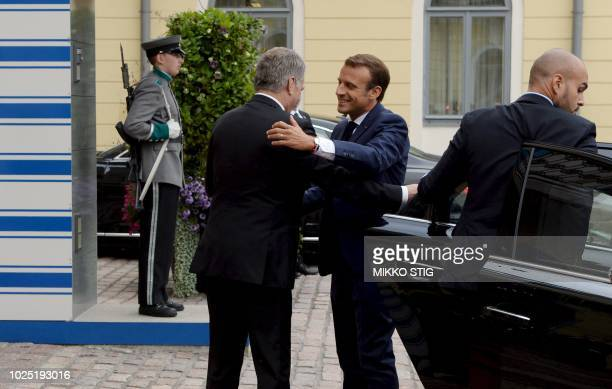 Finnish President Sauli Niinistö welcomes French President Emmanuel Macron prior their official discussions at the Presidential Palace in Helsinki...