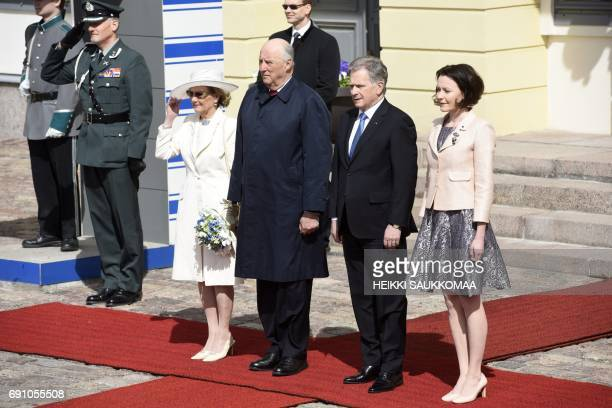Finnish President Sauli Niinisto and his wife Jenni Haukio welcome King Harald V of Norway and his wife Queen Sonja of Norway in front of the...