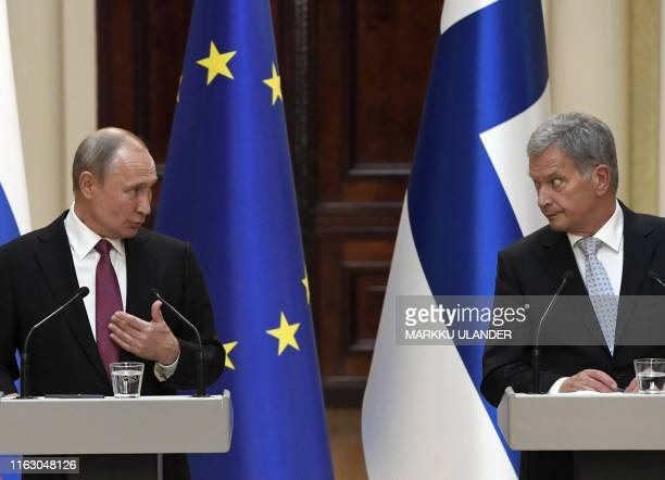 Finnish President Sauli Niinisto and Russian President Vladimir Putin give a press conference after a meeting at the Presidental Palace in Helsinki...