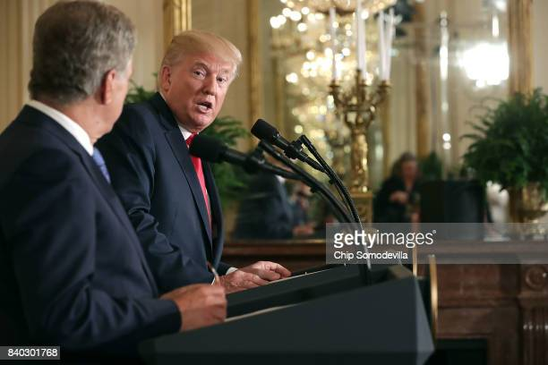 Finnish President Sauli Niinisto and US President Donald Trump hold a joint news conference in the East Room of the White House August 28 2017 in...