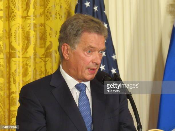 Finnish President Sauli Niinisto rolls his eyes during a joint news conference with US President Donald Trump in the East Room of the White House...