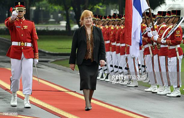 Finnish President Tarja Halonen inspects the honor guard during a welcoming ceremony at the Presidential Palace in Jakarta on February 18 2008...