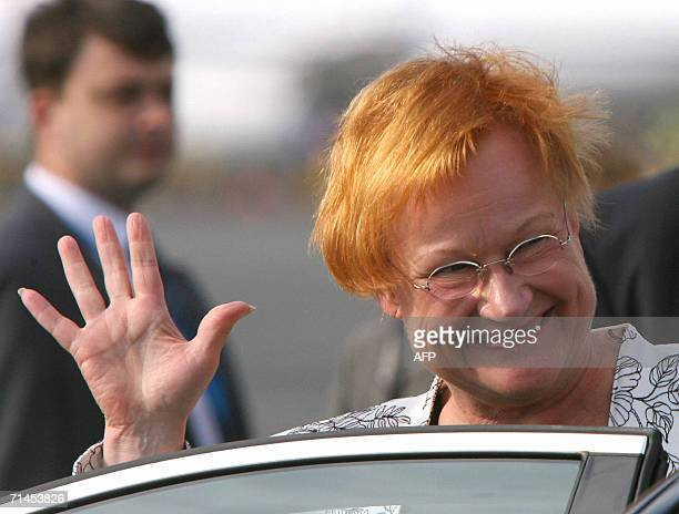 Finnish President Tarja Halonen waves upon arriving at Pulkovo airport, outside St Petersburg, to attend the G8 Summit, 15 July 2006. Leaders of the...