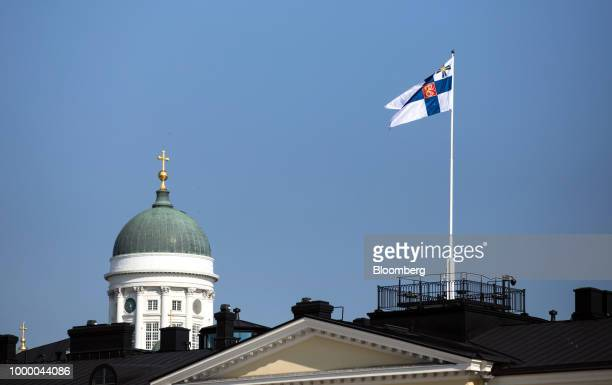 A Finnish presidential flag flies above the Presidential Palace in Helsinki Finland on Monday July 16 2018 US President Donald Trump prepared to meet...