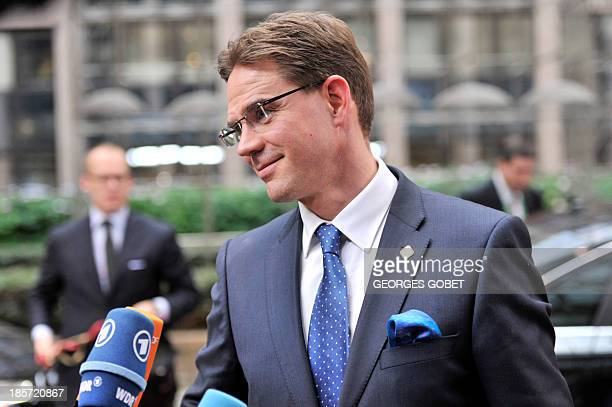 Finnish Prime Minister Jyrki Katainen talks to the press on October 24 2013 as he arrives to attend a European Council meeting at the EU headquarters...