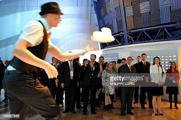 Finnish Prime Minister Mari Kiviniemi watches a performer as she visits the Finnish pavilion at the World Expo 2010 in Shanghai on October 30 2010...
