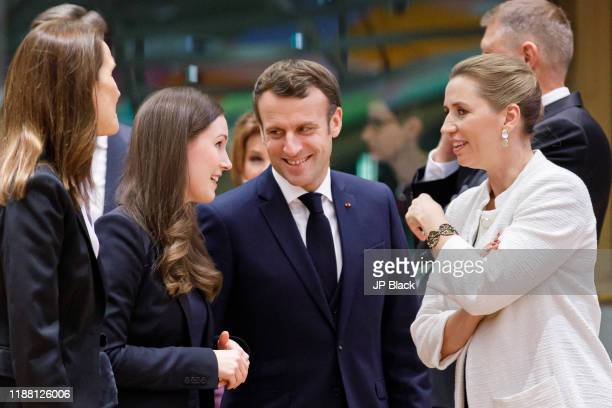 Finnish Prime Minister Sanna Marin talks to the President of France Emmanuel Macron and Danish Prime Minister Mette Frederiksen at the European Union...