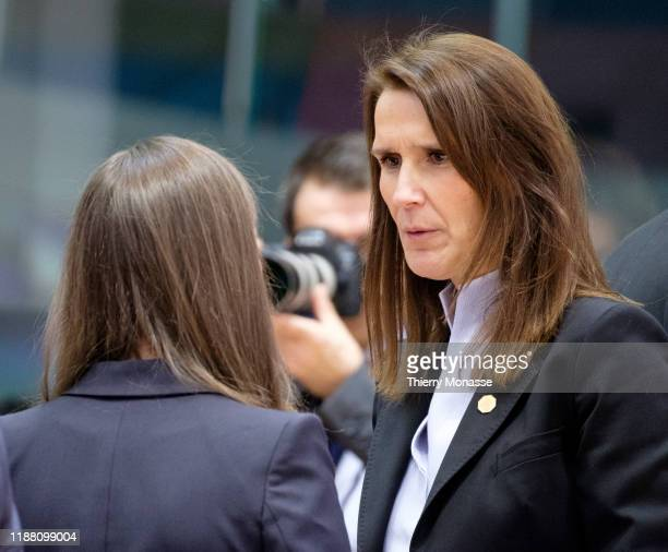 Finnish Prime Minister Sanna Mirella Marin is talking with the Belgium Prime Minister Sophie Wilmes on the first of a twoday summit of European Union...