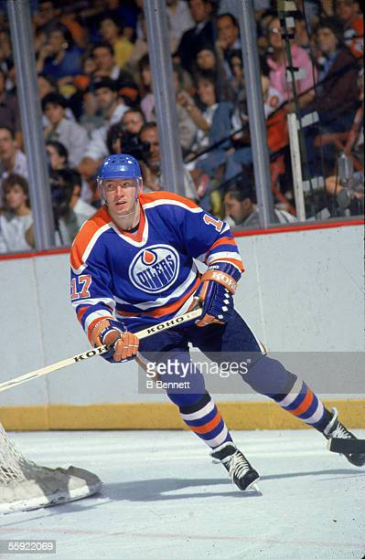 Finnish professional hockey player Jari Kurri of the Edmonton Oilers skates around the back of the goal during an away game 1980s