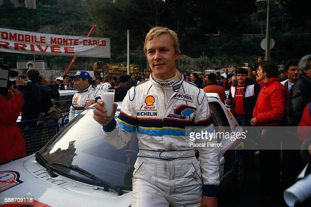 Finnish Racecar Driver Ari Vatanen Drinking Milk During the Monte Carlo Rally