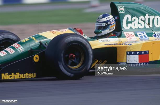 Finnish racing driver Mika Hakkinen drives the Team Lotus Lotus 107 Ford HB 35 V8 to finish in 6th place in the 1992 British Grand Prix at...