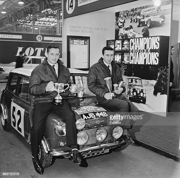 Finnish rally driver Timo Makinen and his codriver Paul Easter hold their trophy after winning the Monte Carlo Rally The drivers and their Mini...