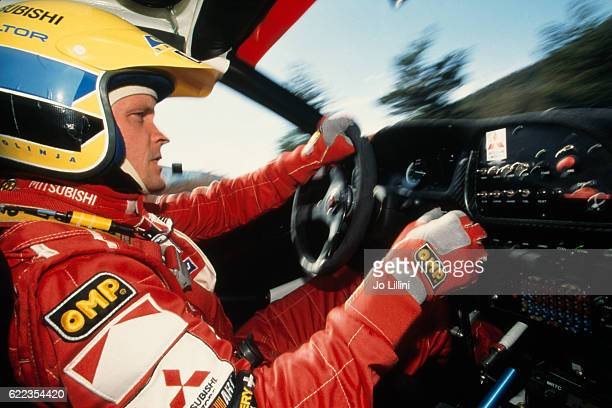 Finnish rally driver Tommi Makinen on Mitsubishi Lancer Evo 6 during the 1999 MonteCarlo rally