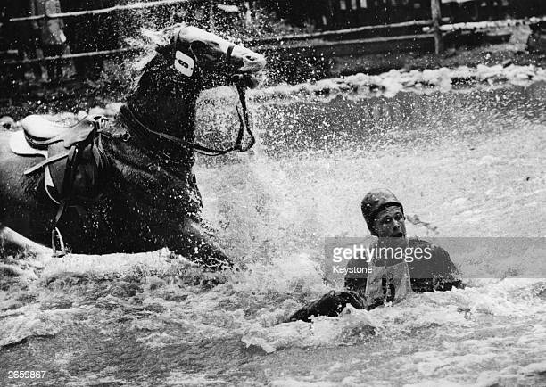 Finnish rider R A Kuistila in the water after falling from his horse during the Equestrian Olympic Games in Stockholm.