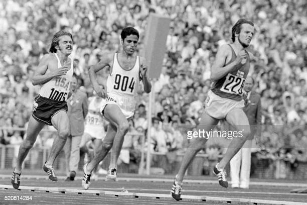 Finnish runner Lasse Viren sprints around the last curve in front of Tunisian Mohammed Gammoudi to win the gold medal in the 5000m final 10 September...