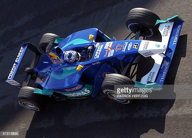 Finnish SauberPetronas driver Kimi Raikkonen steers his car on the Monza racetrack during the second free practice session 15 September 2001 on the...