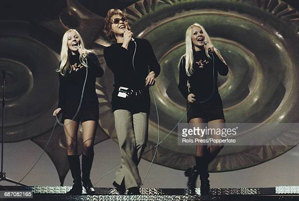 Finnish singer Markku Aro performs the song 'Tie uuteen paivaan' with pop duo Koivistolaiset on stage for Finland in the 1971 Eurovision Song Contest...