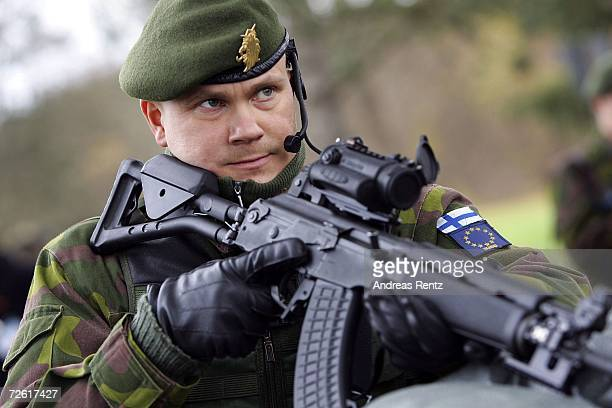 Finnish soldier patrols a military checkpoint on November 21 2006 in Leipheim near Ulm Germany Germany the Netherlands and Finland are working...