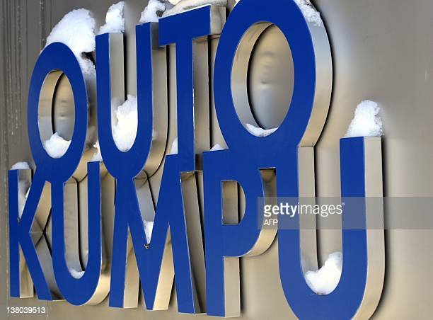 Finnish stainless steel company Outokumpu headquaters logo is pictured snow covered in Espoo on February 1, 2012. Outokumpu and Germany's...