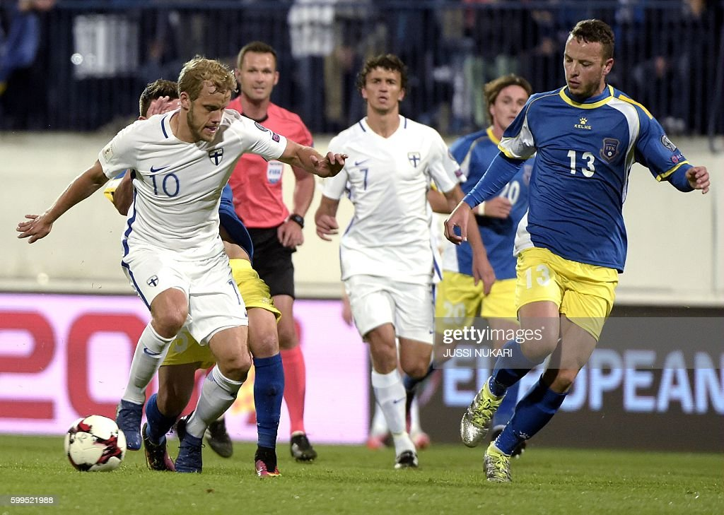 Finnish Teemu Pukki (10) and Kosovar Amir Rrahmani (13) in action during the WC 2018 football qualification match between (group I) Finland vs Kosovo in Turku on September 5, 2016. / AFP / Lehtikuva / Jussi Nukari / Finland OUT
