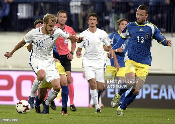 Finnish Teemu Pukki and Kosovar Amir Rrahmani in action during the WC 2018 football qualification match between Finland vs Kosovo in Turku on...