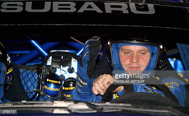 Finnish Tommi Makinen gets ready in his subaru Impreza WRC 2003 during the opening stage of the FIA World Rally Championship in Cardiff Britain 06...
