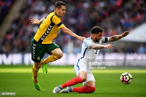 Fiodor Cernych of Lithuania tackles Kyle Walker of England during the FIFA 2018 World Cup Qualifier between England and Lithuania at Wembley Stadium...