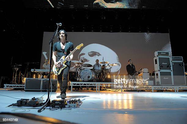 Fiona Brice Brian Molko Steven Forrest and Alex Lee perform on stage at Olympiahalle on November 26 2009 in Munich Germany
