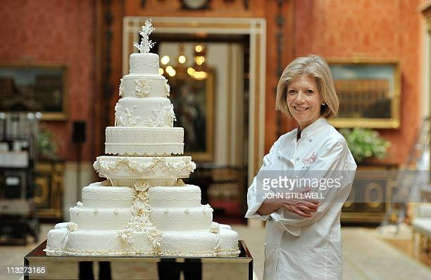 Fiona Cairns stands next to the Royal Wedding cake that she and her team made for Prince William and Kate Middleton, in the Picture Gallery of...