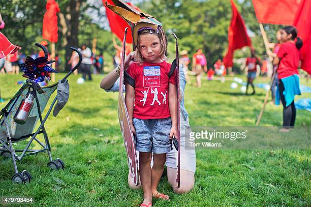 Fiona Dahlkemper of Philadelphia is dressed in a bird costume during a playin protest by kids and mothers in Upper Senate Park organized by Moms...