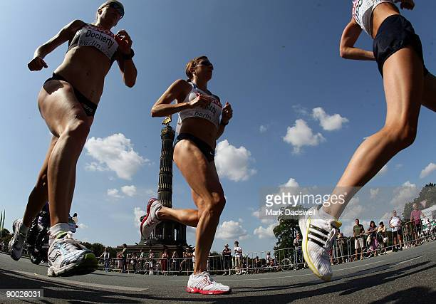 Fiona Docherty of New Zealand and other athletes race past the Berlin Victory Column as they compete in the women's Marathon Final during day nine of...