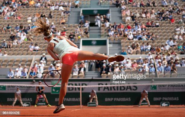 Fiona Ferro of France serves during her womens singles second round match against Garbine Muguruza of Spain during day 5 of the 2018 French Open at...